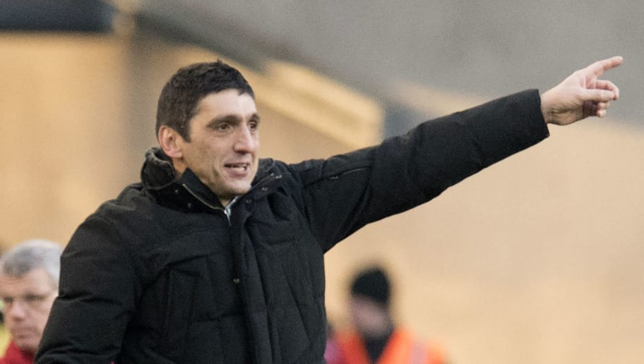 Stuttgart's Turkish head coach Tayfun Korkut gestures during the German first division Bundesliga football match VfB Stuttgart vs Eintracht Frankfurt on February 24, 2018 in Stuttgart, Germany. / AFP PHOTO / THOMAS KIENZLE / RESTRICTIONS: DURING MATCH TIME: DFL RULES TO LIMIT THE ONLINE USAGE TO 15 PICTURES PER MATCH AND FORBID IMAGE SEQUENCES TO SIMULATE VIDEO. == RESTRICTED TO EDITORIAL USE == FOR FURTHER QUERIES PLEASE CONTACT DFL DIRECTLY AT + 49 69 650050         (Photo credit should read THOMAS KIENZLE/AFP/Getty Images)