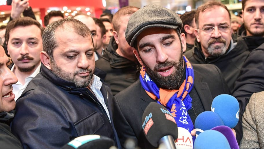 Barcelona's Turkish midfielder Arda Turan speaks to the media as he arrives at Ataturk International Airport in Istanbul on January 13, 2018.    Turkish league leaders Istanbul Basaksehir on January 13 announced they had reached an agreement to sign midfielder Arda Turan on loan from Barcelona before the player's homecoming sparked an embarrassing airport brawl. / AFP PHOTO / OZAN KOSE        (Photo credit should read OZAN KOSE/AFP/Getty Images)