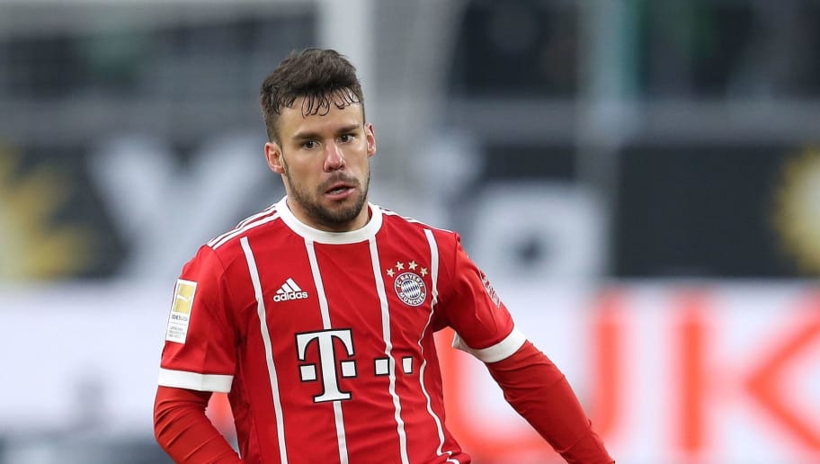 Bayern Munich's Spanish defender Juan Bernat runs with the ball during the German first division Bundesliga football match VfL Wolfsburg vs FC Bayern Munich at Volkswagen Arena on February 17, 2018 in Wolfsburg, Germany. / AFP PHOTO / Ronny Hartmann / RESTRICTIONS: DURING MATCH TIME: DFL RULES TO LIMIT THE ONLINE USAGE TO 15 PICTURES PER MATCH AND FORBID IMAGE SEQUENCES TO SIMULATE VIDEO. == RESTRICTED TO EDITORIAL USE == FOR FURTHER QUERIES PLEASE CONTACT DFL DIRECTLY AT + 49 69 650050         (Photo credit should read RONNY HARTMANN/AFP/Getty Images)