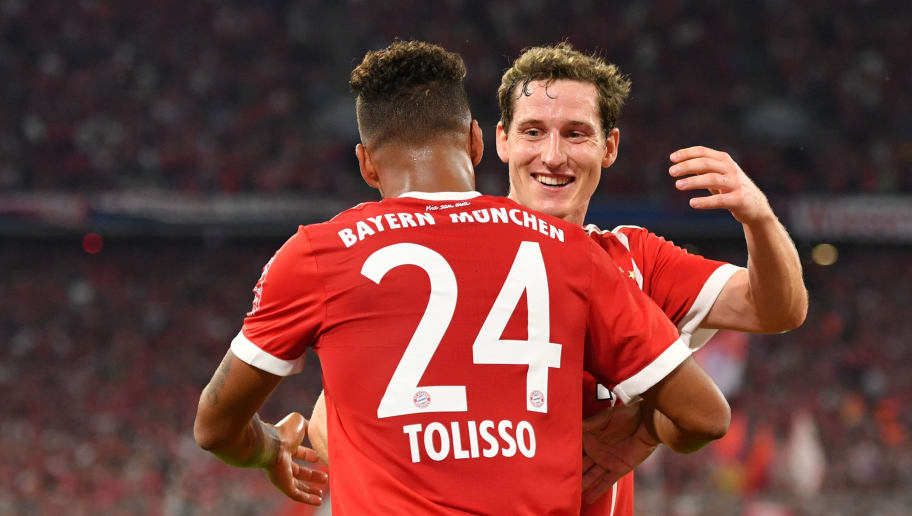 MUNICH, GERMANY - AUGUST 18: Corentin Tolisso of FC Bayern Muenchen celebrates his goal with teammate Sebastian Rudy during the Bundesliga match between FC Bayern Muenchen and Bayer 04 Leverkusen at Allianz Arena on August 18, 2017 in Munich, Germany. (Photo by Sebastian Widmann/Bongarts/Getty Images)