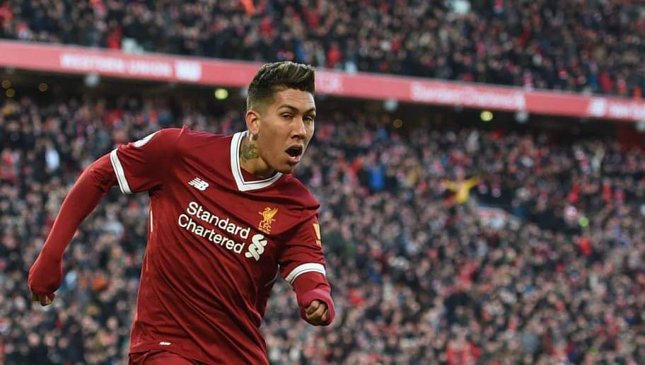 Liverpool's Brazilian midfielder Roberto Firmino (R) celebrates scoring the team's third goal during the English Premier League football match between Liverpool and West Ham United at Anfield in Liverpool, north west England on February 24, 2018. / AFP PHOTO / Oli SCARFF / RESTRICTED TO EDITORIAL USE. No use with unauthorized audio, video, data, fixture lists, club/league logos or 'live' services. Online in-match use limited to 75 images, no video emulation. No use in betting, games or single club/league/player publications.  /         (Photo credit should read OLI SCARFF/AFP/Getty Images)