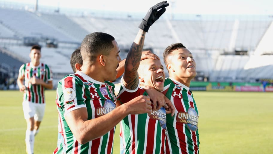 Marcos Junior of  Brazilian club Fluminense (C) celebrates with teammates after scoring a goal in the first half against Barcelona SC of Ecuador during their Florida Cup soccer game at Spectrum Stadium in Orlando, Florida on January 15, 2018.  / AFP PHOTO / Gregg Newton        (Photo credit should read GREGG NEWTON/AFP/Getty Images)