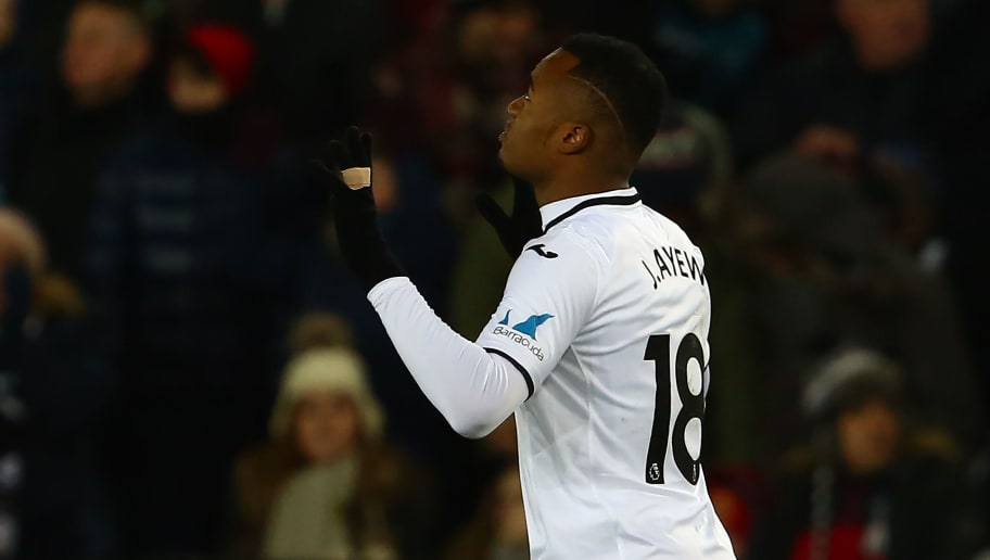 Swansea City's Ghanaian striker Jordan Ayew celebrates scoring the opening goal during the English FA Cup 5th round replay football match between Swansea City and Sheffield Wednesday at The Liberty Stadium in Swansea, south Wales on February 27, 2018. / AFP PHOTO / Geoff CADDICK / RESTRICTED TO EDITORIAL USE. No use with unauthorized audio, video, data, fixture lists, club/league logos or 'live' services. Online in-match use limited to 75 images, no video emulation. No use in betting, games or single club/league/player publications.  /         (Photo credit should read GEOFF CADDICK/AFP/Getty Images)