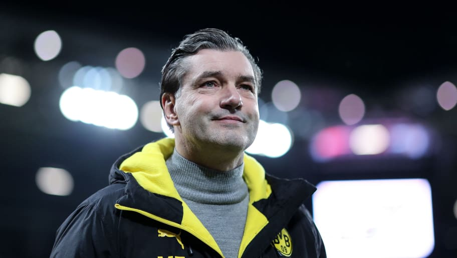 MAINZ, GERMANY - DECEMBER 12: Manager Michael Zorc of Dortmund looks on prior the Bundesliga match between 1. FSV Mainz 05 and Borussia Dortmund at Opel Arena on December 12, 2017 in Mainz, Germany. (Photo by Simon Hofmann/Bongarts/Getty Images )