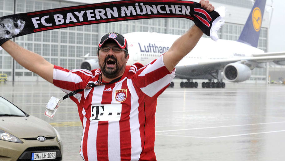 Airport staff and FC Bayern fan Georg Forster, celebrates in front of the airbus A380 upon the arrival of FC Bayern Munich at the Munich airport on May 26, 2013, one day after their victory in the UEFA Champions League final football match between Borussia Dortmund and Bayern Munich at Wembley Stadium in London. AFP PHOTO / UWE LEIN        (Photo credit should read UWE LEIN/AFP/Getty Images)