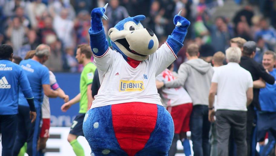 HAMBURG, GERMANY - MAY 20: mascot Dino Hermann of HSV celebrate after the Bundesliga match between Hamburger SV and VfL Wolfsburg at Volksparkstadion on May 20, 2017 in Hamburg, Germany. (Photo by Selim Sudheimer/Bongarts/Getty Images)