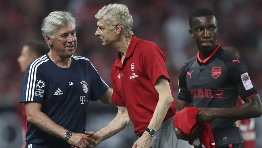 SHANGHAI, CHINA - JULY 19:  Arsene Wenger coach of Arsenal FCshake hands with Head coach Carlo Ancelotti of FC Bayern Muenchen after the 2017 International Champions Cup football match between FC Bayern and Arsenal FC at Shanghai Stadium on July 19, 2017 in Shanghai, China.  (Photo by Lintao Zhang/Getty Images)