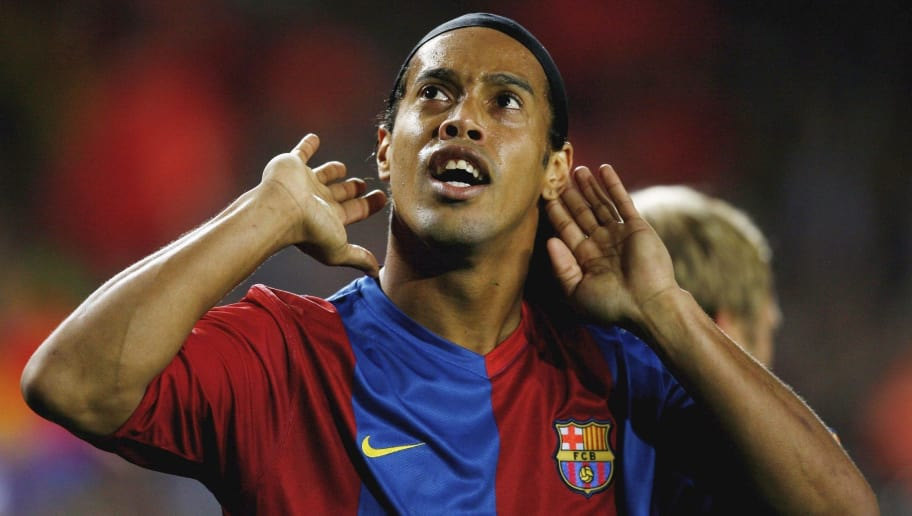 BARCELONA, SPAIN - DECEMBER 05:  Ronaldinho of Barcelona celebrates after scoring during the UEFA Champions League Group A match between Barcelona and Werder Bremen at the Nou Camp on December 5, 2006 in Barcelona, Spain.  (Photo by Shaun Botterill/Getty Images)
