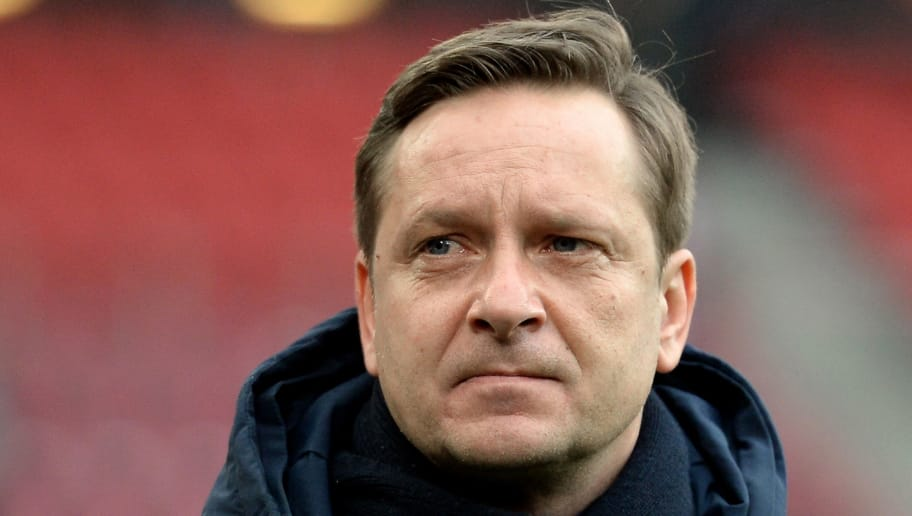 COLOGNE, GERMANY - MARCH 05:  Manager Horst Heldt of Schalke looks on prior to the Bundesliga match between 1. FC Koeln and FC Schalke 04 at RheinEnergieStadion on March 5, 2016 in Cologne, Germany.  (Photo by Sascha Steinbach/Bongarts/Getty Images)