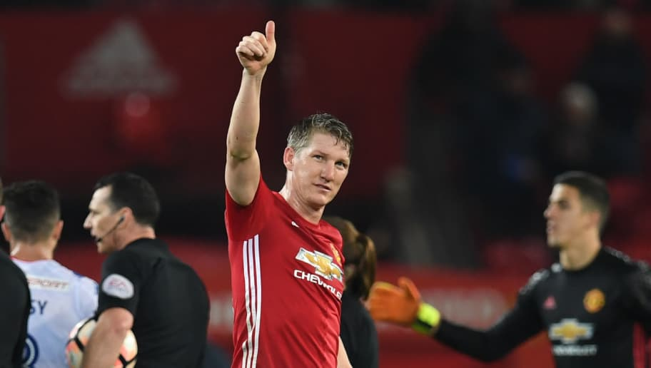 Manchester United's German midfielder Bastian Schweinsteiger (C) salutes the crowd at the end of the English FA Cup fourth round football match between Manchester United and Wigan Athletic at Old Trafford in Manchester, north west England, on January 29, 2017. / AFP / Paul ELLIS / RESTRICTED TO EDITORIAL USE. No use with unauthorized audio, video, data, fixture lists, club/league logos or 'live' services. Online in-match use limited to 75 images, no video emulation. No use in betting, games or single club/league/player publications.  /         (Photo credit should read PAUL ELLIS/AFP/Getty Images)