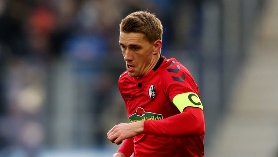 SINSHEIM, GERMANY - FEBRUARY 24: Nils Petersen of Freiburg runs with the ball during the Bundesliga match between TSG 1899 Hoffenheim and Sport-Club Freiburg at Wirsol Rhein-Neckar-Arena on February 24, 2018 in Sinsheim, Germany. The match between Hoffenheim and Freiburg ended 1-1. (Photo by Christof Koepsel/Bongarts/Getty Images)