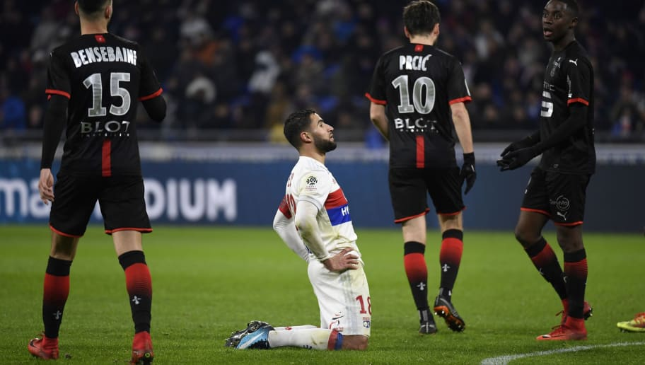 Lyon's French midfielder Nabil Fekir (C) reacts after missing a goal opportunity  next to Rennes' Algerian defender Ramy Bensebaini (L), Rennes' French midfielder Sanjin Prcic (2nd R) and Rennes' French defender Ludovic Baal (R) during the French L1 football match between Lyon (OL) and Rennes (SRFC) on February 11, 2018, at the Groupama Stadium in Decines-Charpieu near Lyon, central-eastern France.  / AFP PHOTO / PHILIPPE DESMAZES        (Photo credit should read PHILIPPE DESMAZES/AFP/Getty Images)