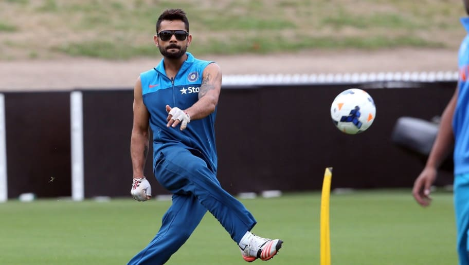 India's Virat Kohli plays football during a cricket training session ahead of their 2015 Cricket World Cup Group B match against Ireland, in Hamilton on March 9, 2015.AFP PHOTO / Michael Bradley        (Photo credit should read MICHAEL BRADLEY/AFP/Getty Images)