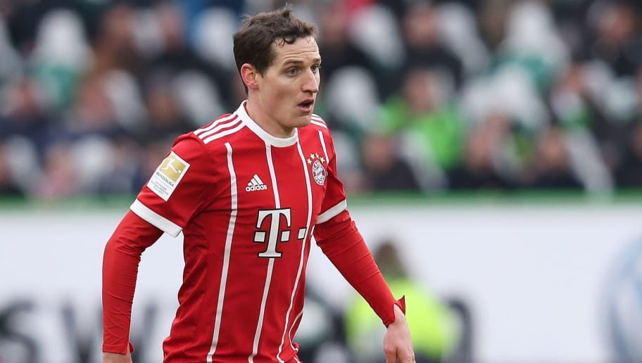Bayern Munich's German midfielder Sebastian Rudy runs with the ball during the German first division Bundesliga football match VfL Wolfsburg vs FC Bayern Munich at Volkswagen Arena on February 17, 2018 in Wolfsburg, Germany. / AFP PHOTO / Ronny Hartmann / RESTRICTIONS: DURING MATCH TIME: DFL RULES TO LIMIT THE ONLINE USAGE TO 15 PICTURES PER MATCH AND FORBID IMAGE SEQUENCES TO SIMULATE VIDEO. == RESTRICTED TO EDITORIAL USE == FOR FURTHER QUERIES PLEASE CONTACT DFL DIRECTLY AT + 49 69 650050         (Photo credit should read RONNY HARTMANN/AFP/Getty Images)
