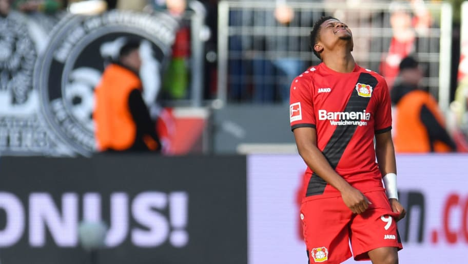Leverkusen's Jamaican midfielder Leon Bailey (R) reacts during the German first division Bundesliga football match Bayer Leverkusen vs Schalke 04 in Leverkusen, western Germany, on February 25, 2018. / AFP PHOTO / Patrik STOLLARZ / RESTRICTIONS: DURING MATCH TIME: DFL RULES TO LIMIT THE ONLINE USAGE TO 15 PICTURES PER MATCH AND FORBID IMAGE SEQUENCES TO SIMULATE VIDEO. == RESTRICTED TO EDITORIAL USE == FOR FURTHER QUERIES PLEASE CONTACT DFL DIRECTLY AT + 49 69 650050         (Photo credit should read PATRIK STOLLARZ/AFP/Getty Images)