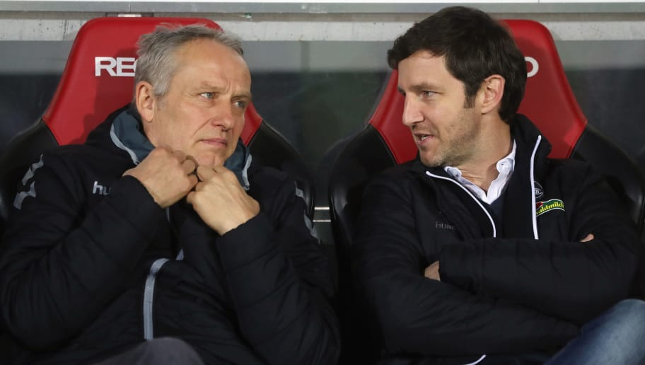 FREIBURG IM BREISGAU, GERMANY - DECEMBER 01:  Head coach Christian Streich and sport director Jochen Saier of Freiburg chat prior to the Bundesliga match between Sport-Club Freiburg and Hamburger SV at Schwarzwald-Stadion on December 1, 2017 in Freiburg im Breisgau, Germany.  (Photo by Alex Grimm/Bongarts/Getty Images)