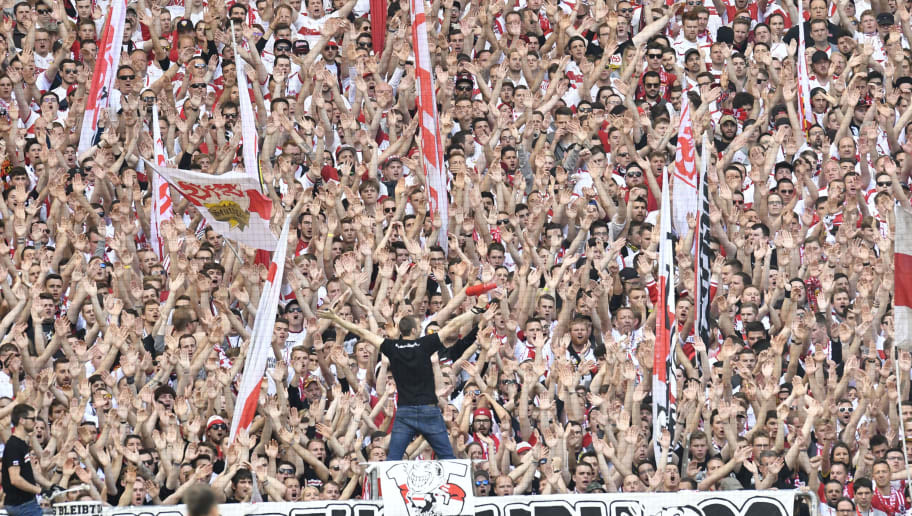 Fans of VfB Stuttgart cheer their team during the German second division Bundesliga football match VfB Stuttgart vs FC Wuerzburger Kickers in Stuttgart, southwestern Germany, on May 21, 2017.     / AFP PHOTO / THOMAS KIENZLE / RESTRICTIONS: DURING MATCH TIME: DFL RULES TO LIMIT THE ONLINE USAGE TO 15 PICTURES PER MATCH AND FORBID IMAGE SEQUENCES TO SIMULATE VIDEO. == RESTRICTED TO EDITORIAL USE == FOR FURTHER QUERIES PLEASE CONTACT DFL DIRECTLY AT + 49 69 650050         (Photo credit should read THOMAS KIENZLE/AFP/Getty Images)