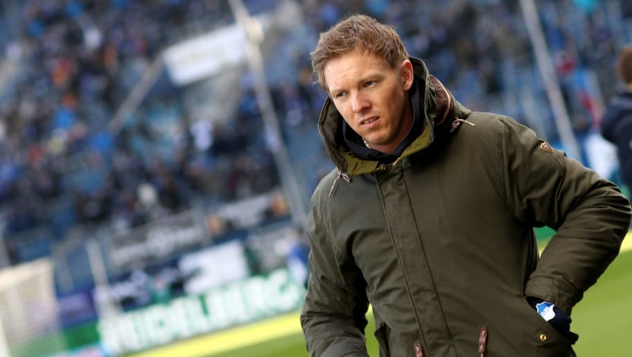 SINSHEIM, GERMANY - FEBRUARY 24: Head coach Julian Nagelsmann of Hoffenheim looks on prior to the Bundesliga match between TSG 1899 Hoffenheim and Sport-Club Freiburg at Wirsol Rhein-Neckar-Arena on February 24, 2018 in Sinsheim, Germany. (Photo by Christof Koepsel/Bongarts/Getty Images)