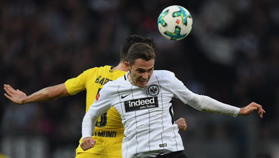 FRANKFURT AM MAIN, GERMANY - OCTOBER 21: Branimir Hrgota of Frankfurt jumps for a header with Marc Bartra Aregall of Dortmund during the Bundesliga match between Eintracht Frankfurt and Borussia Dortmund at Commerzbank-Arena on October 21, 2017 in Frankfurt am Main, Germany. (Photo by Matthias Hangst/Bongarts/Getty Images)