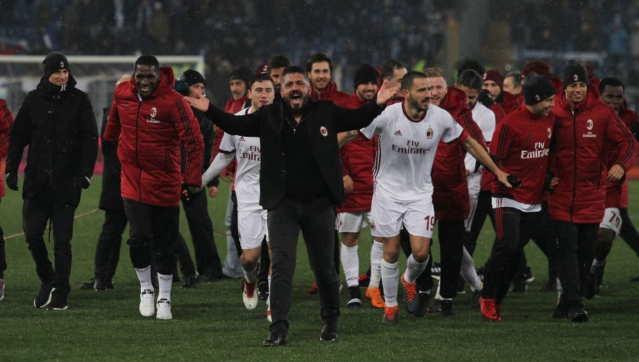 ROME, ITALY - FEBRUARY 28:  AC Milan head coach Gennaro Gattuso and Leonardo Bonucci with his teammates of AC Milan celebrate the victory after the TIM Cup match between SS Lazio and AC Milan at Olimpico Stadium on February 28, 2018 in Rome, Italy.  (Photo by Paolo Bruno/Getty Images)