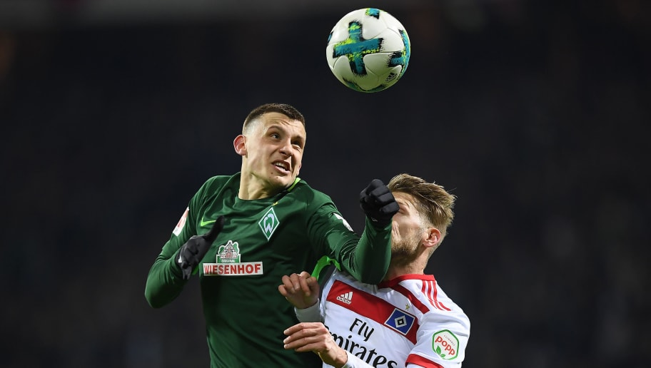 BREMEN, GERMANY - FEBRUARY 24: Maximilian Eggestein of Bremen (l) fights for the ball with Aaron Hunt of Hamburg during the Bundesliga match between SV Werder Bremen and Hamburger SV at Weserstadion on February 24, 2018 in Bremen, Germany. (Photo by Lukas Schulze/Bongarts/Getty Images)