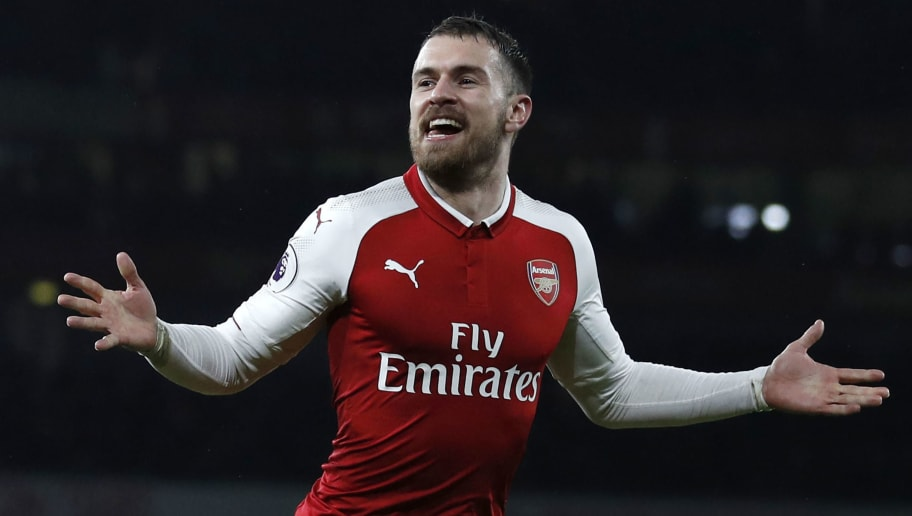Arsenal's Welsh midfielder Aaron Ramsey celebrates scoring the team's fifth goal during the English Premier League football match between Arsenal and Everton at the Emirates Stadium in London on February 3, 2018.  / AFP PHOTO / Adrian DENNIS / RESTRICTED TO EDITORIAL USE. No use with unauthorized audio, video, data, fixture lists, club/league logos or 'live' services. Online in-match use limited to 75 images, no video emulation. No use in betting, games or single club/league/player publications.  /         (Photo credit should read ADRIAN DENNIS/AFP/Getty Images)