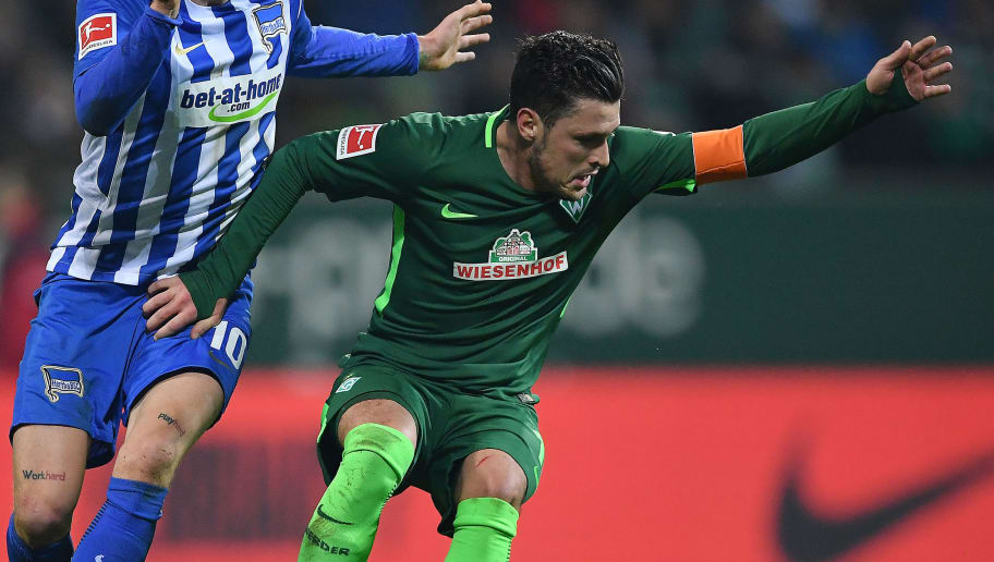 BREMEN, GERMANY - JANUARY 27: Zlatko Junuzovic of Bremen (r) fights for the ball with Ondrej Duda of Berlin during the Bundesliga match between SV Werder Bremen and Hertha BSC at Weserstadion on January 27, 2018 in Bremen, Germany. (Photo by Stuart Franklin/Bongarts/Getty Images)