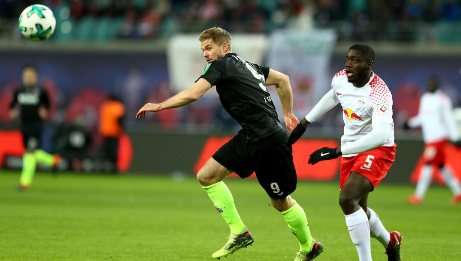 LEIPZIG, GERMANY - FEBRUARY 25: Upamecano (R) of Leipzig and Simon Terodde of Koeln battle for the ball during the Bundesliga match between RB Leipzig and 1. FC Koeln at Red Bull Arena on February 25, 2018 in Leipzig, Germany.  (Photo by Martin Rose/Bongarts/Getty Images)