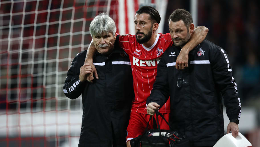 COLOGNE, GERMANY - NOVEMBER 23: Injured Dominic Maroh of Koeln leaves the pitch during the UEFA Europa League group H match between 1. FC Koeln and Arsenal FC at RheinEnergieStadion on November 23, 2017 in Cologne, Germany. (Photo by Maja Hitij/Bongarts/Getty Images)