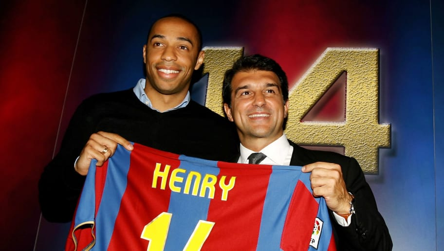 BARCELONA, SPAIN - JUNE 25:  Former Arsenal forward Thierry Henry (L) poses with his new shirt and Barcelona President Joan Laporta after a press conference at the Nou Camp on June 25, 2007 in Barcelona, Spain.  (Photo by Shaun Botterill/Getty Images)