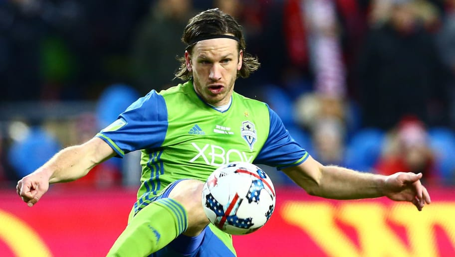 TORONTO, ON - DECEMBER 09:  Gustav Svensson #4 of the Seattle Sounders clears the ball during the 2017 MLS Cup Final against Toronto FC at BMO Field on December 9, 2017 in Toronto, Ontario, Canada.  (Photo by Vaughn Ridley/Getty Images)