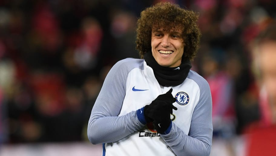 36aed26c042 Chelsea s Brazilian defender David Luiz warms up on the pitch ahead of the  English Premier League