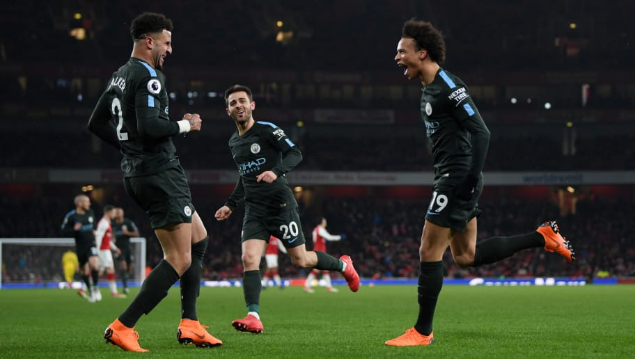 LONDON, ENGLAND - MARCH 01:  Leroy Sane of Manchester City celebrates the third goal with Kyle Walker and Bernardo Silva during the Premier League match between Arsenal and Manchester City at Emirates Stadium on March 1, 2018 in London, England.  (Photo by Shaun Botterill/Getty Images)