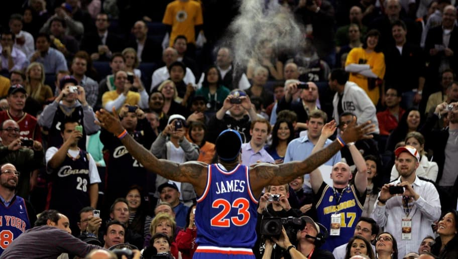 OAKLAND, CA - JANUARY 11:  LeBron James #23 of the Cleveland Cavaliers throws chalk up in the air before their game against the Golden State Warriors at Oracle Arena on January 11, 2010 in Oakland, California.  NOTE TO USER: User expressly acknowledges and agrees that, by downloading and/or using this Photograph, user is consenting to the terms and conditions of the Getty Images License Agreement.  (Photo by Ezra Shaw/Getty Images)