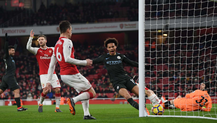 LONDON, ENGLAND - MARCH 01:  Leroy Sane of Manchester City scores the third goal past Petr Cech of Arsenal during the Premier League match between Arsenal and Manchester City at Emirates Stadium on March 1, 2018 in London, England.  (Photo by Shaun Botterill/Getty Images)