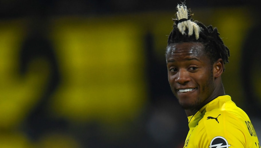 Dortmund's Belgian striker Michy Batshuayi reacts during the German first division Bundesliga football match Borussia Dortmund vs FC Augsburg, in Dortmund, western Germany, on February 26, 2018. / AFP PHOTO / Patrik STOLLARZ / RESTRICTIONS: DURING MATCH TIME: DFL RULES TO LIMIT THE ONLINE USAGE TO 15 PICTURES PER MATCH AND FORBID IMAGE SEQUENCES TO SIMULATE VIDEO. == RESTRICTED TO EDITORIAL USE == FOR FURTHER QUERIES PLEASE CONTACT DFL DIRECTLY AT + 49 69 650050         (Photo credit should read PATRIK STOLLARZ/AFP/Getty Images)