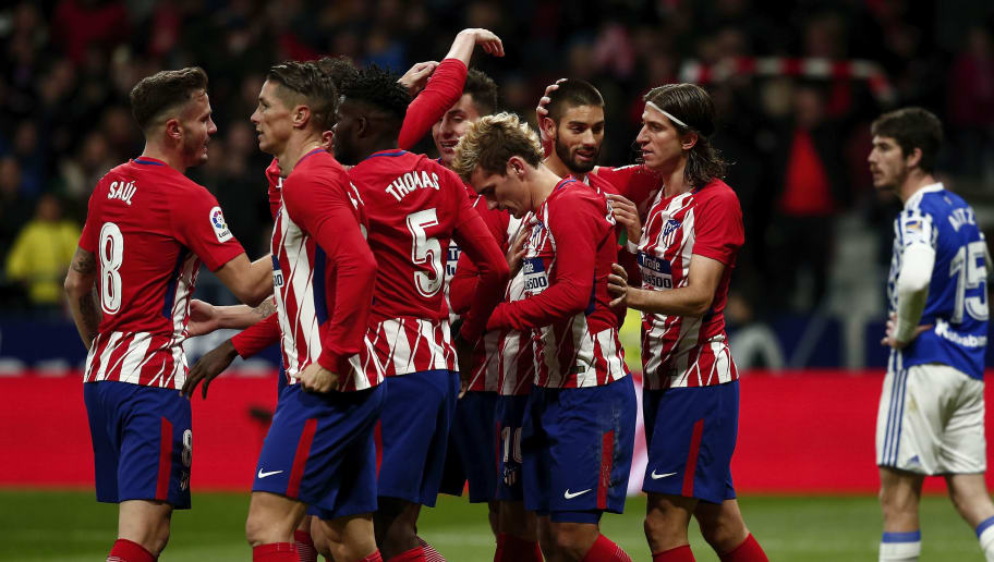 MADRID, SPAIN - DECEMBER 02: Antoine Griezmann (3dR) of Atletico de Madrid celebrates scoring their second goal with teammates Filipe Luis (L),Yannick Carrasco(2ndL), Jose Maria Gimenez (4thR), Thomas Teye Partey (3dL), Fernando Torres (2ndL) and Saul Niguez (L) during the La Liga match between Club Atletico Madrid and Real Sociedad de Futbol at Estadio Wanda Metropolitano on December 2, 2017 in Madrid, Spain. (Photo by Gonzalo Arroyo Moreno/Getty Images)
