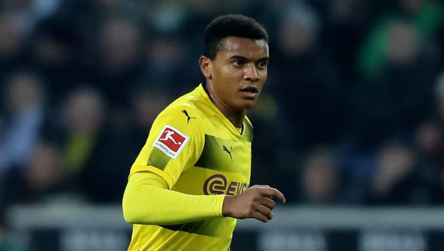 MOENCHENGLADBACH, GERMANY - FEBRUARY 18: Manuek Akanji of Dortmund runs with the ball during the Bundesliga match between Borussia Moenchengladbach and Borussia Dortmund at Borussia-Park on February 18, 2018 in Moenchengladbach, Germany. The match between Moenchengladbach and Dortmund ended 0-1. (Photo by Christof Koepsel/Bongarts/Getty Images)
