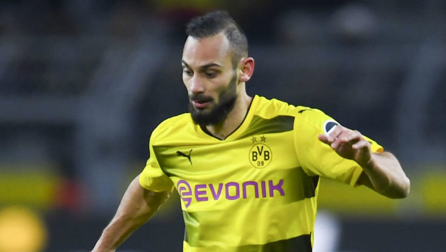 Dortmund's Turkish defender Omer Toprak plays the ball during the German first division Bundesliga football match Borussia Dortmund vs FC Augsburg, in Dortmund, western Germany, on February 26, 2018. / AFP PHOTO / Patrik STOLLARZ / RESTRICTIONS: DURING MATCH TIME: DFL RULES TO LIMIT THE ONLINE USAGE TO 15 PICTURES PER MATCH AND FORBID IMAGE SEQUENCES TO SIMULATE VIDEO. == RESTRICTED TO EDITORIAL USE == FOR FURTHER QUERIES PLEASE CONTACT DFL DIRECTLY AT + 49 69 650050         (Photo credit should read PATRIK STOLLARZ/AFP/Getty Images)