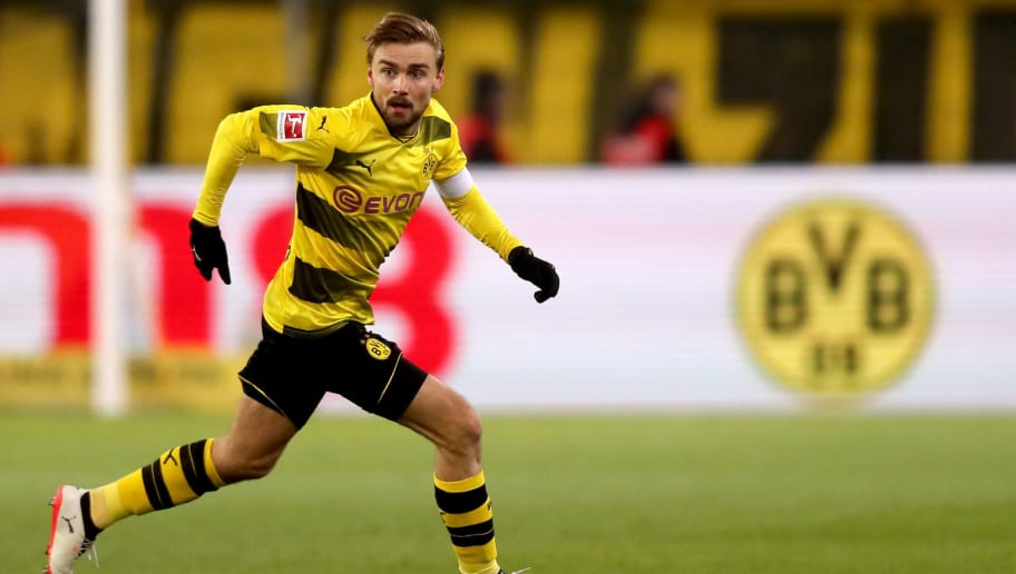 DORTMUND, GERMANY - FEBRUARY 26: Marcel Schmelzer of Dortmund runs with the ball during the Bundesliga match between Borussia Dortmund and FC Augsburg at Signal Iduna Park on February 26, 2018 in Dortmund, Germany. (Photo by Christof Koepsel/Bongarts/Getty Images)