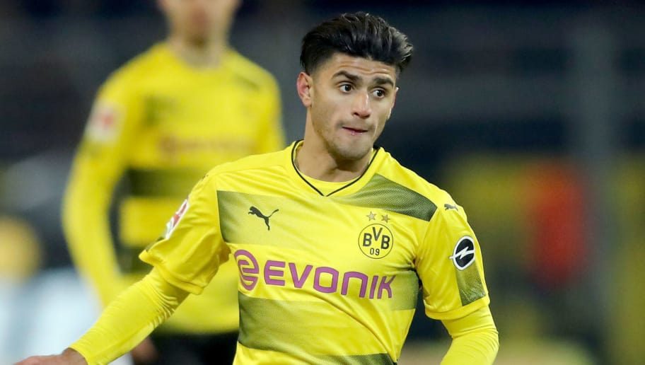 DORTMUND, GERMANY - FEBRUARY 26: Mahmoud Dahoud of Dortmund runs with the ball during the Bundesliga match between Borussia Dortmund and FC Augsburg at Signal Iduna Park on February 26, 2018 in Dortmund, Germany. (Photo by Christof Koepsel/Bongarts/Getty Images)