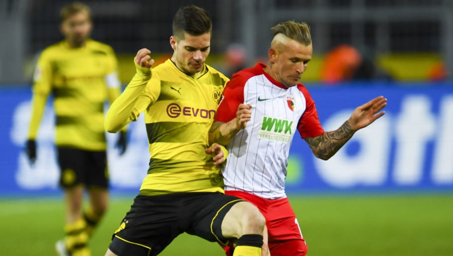 Augsburg's French midfielder Jonathan Schmid (R) and Dortmund's German midfielder Julian Weigl vie for the ball during the German first division Bundesliga football match Borussia Dortmund vs FC Augsburg, in Dortmund, western Germany, on February 26, 2018. / AFP PHOTO / Patrik STOLLARZ / RESTRICTIONS: DURING MATCH TIME: DFL RULES TO LIMIT THE ONLINE USAGE TO 15 PICTURES PER MATCH AND FORBID IMAGE SEQUENCES TO SIMULATE VIDEO. == RESTRICTED TO EDITORIAL USE == FOR FURTHER QUERIES PLEASE CONTACT DFL DIRECTLY AT + 49 69 650050         (Photo credit should read PATRIK STOLLARZ/AFP/Getty Images)