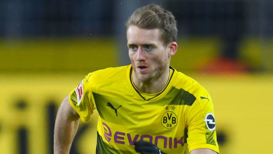 Dortmund's German midfielder Andre Schuerrle plays the ball during the German first division Bundesliga football match Borussia Dortmund vs FC Augsburg, in Dortmund, western Germany, on February 26, 2018. / AFP PHOTO / Patrik STOLLARZ / RESTRICTIONS: DURING MATCH TIME: DFL RULES TO LIMIT THE ONLINE USAGE TO 15 PICTURES PER MATCH AND FORBID IMAGE SEQUENCES TO SIMULATE VIDEO. == RESTRICTED TO EDITORIAL USE == FOR FURTHER QUERIES PLEASE CONTACT DFL DIRECTLY AT + 49 69 650050         (Photo credit should read PATRIK STOLLARZ/AFP/Getty Images)