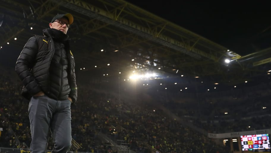 DORTMUND, GERMANY - FEBRUARY 26:  Peter Stoeger, head coach of Dortmund stands  in front of an almost empty south stand that normally holds 26,000 fans as the fans make their protest against monday evening matches prior to  the Bundesliga match between Borussia Dortmund and FC Augsburg at Signal Iduna Park on February 26, 2018 in Dortmund, Germany.  (Photo by Christof Koepsel/Bongarts/Getty Images)