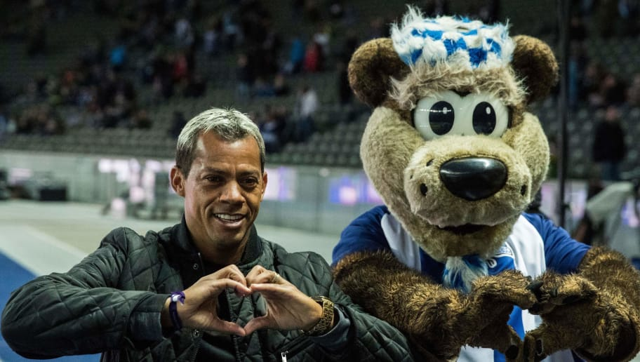 Former Hertha Berlin player Marcelinho Paraiba of Brazil is seen with the team mascot prior to the German first division Bundesliga football match between Hertha Berlin and Eintracht Frankfurt in Berlin, Germany, on February 25, 2017. / AFP PHOTO / Odd ANDERSEN / RESTRICTIONS: DURING MATCH TIME: DFL RULES TO LIMIT THE ONLINE USAGE TO 15 PICTURES PER MATCH AND FORBID IMAGE SEQUENCES TO SIMULATE VIDEO. == RESTRICTED TO EDITORIAL USE == FOR FURTHER QUERIES PLEASE CONTACT DFL DIRECTLY AT + 49 69 650050         (Photo credit should read ODD ANDERSEN/AFP/Getty Images)