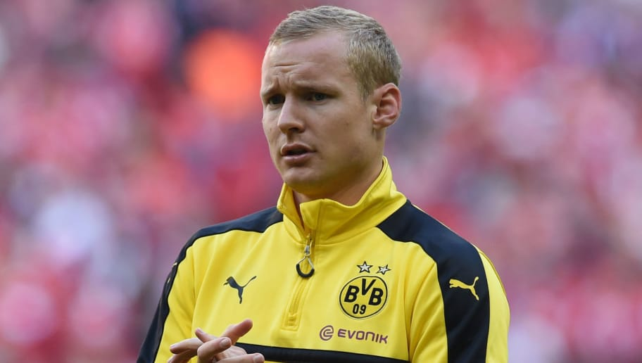 Dortmund's midfielder Sebastian Rode is pictured during the warm-up prior to the German first division Bundesliga football match FC Bayern Munich v BVB Borussia Dortmund in Munich, southern Germany, on April 8, 2017. / AFP PHOTO / Christof STACHE / RESTRICTIONS: DURING MATCH TIME: DFL RULES TO LIMIT THE ONLINE USAGE TO 15 PICTURES PER MATCH AND FORBID IMAGE SEQUENCES TO SIMULATE VIDEO. == RESTRICTED TO EDITORIAL USE == FOR FURTHER QUERIES PLEASE CONTACT DFL DIRECTLY AT + 49 69 650050         (Photo credit should read CHRISTOF STACHE/AFP/Getty Images)