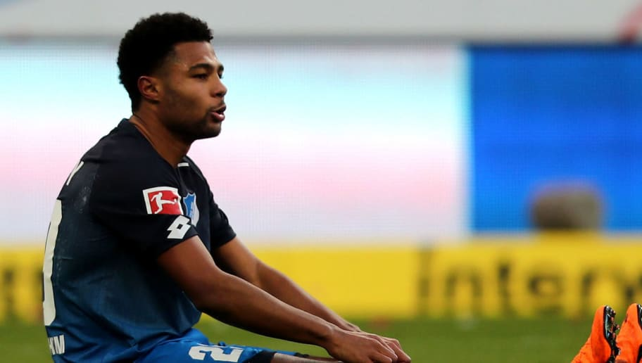 SINSHEIM, GERMANY - FEBRUARY 24: Serge Gnabry of Hoffenheim looks dejected after the Bundesliga match between TSG 1899 Hoffenheim and Sport-Club Freiburg at Wirsol Rhein-Neckar-Arena on February 24, 2018 in Sinsheim, Germany. The match between Hoffenheim and Freiburg ended 1-1. (Photo by Christof Koepsel/Bongarts/Getty Images)
