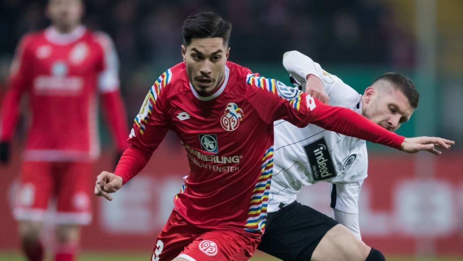FRANKFURT AM MAIN, GERMANY - FEBRUARY 07: Ante Rebic of Frankfurt is challenged by Suat Serdar of Mainz during the DFB Cup quarter final match between Eintracht Frankfurt and 1. FSV Mainz 05 at Commerzbank-Arena on February 7, 2018 in Frankfurt am Main, Germany. (Photo by Simon Hofmann/Bongarts/Getty Images)