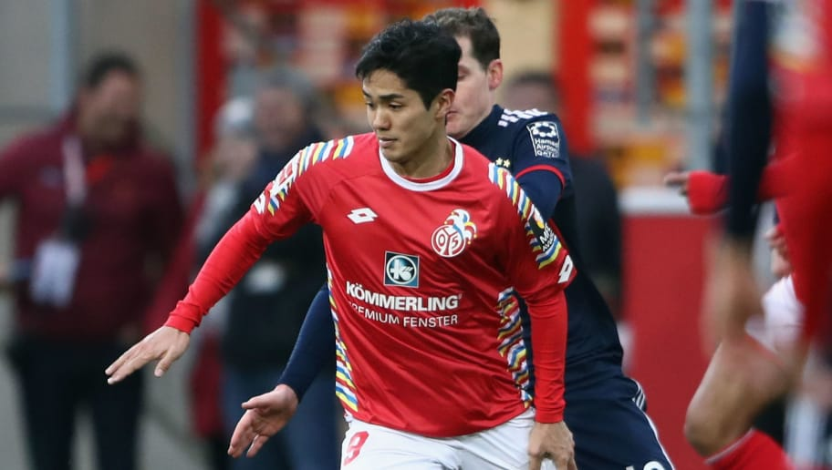 MAINZ, GERMANY - FEBRUARY 03: Yoshinori Muto of Mainz is challenged by Sebastian Rudy of Mainz during the Bundesliga match between 1. FSV Mainz 05 and FC Bayern Muenchen at Opel Arena on February 3, 2018 in Mainz, Germany.  (Photo by Alex Grimm/Bongarts/Getty Images)