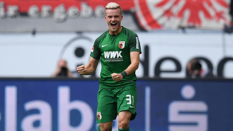 FRANKFURT AM MAIN, GERMANY - SEPTEMBER 16: Philipp Max of Augsburg celebrates with his team-mates after scoring his team's first goal during the Bundesliga match between Eintracht Frankfurt and FC Augsburg at Commerzbank-Arena on September 16, 2017 in Frankfurt am Main, Germany. (Photo by Matthias Hangst/Bongarts/Getty Images)